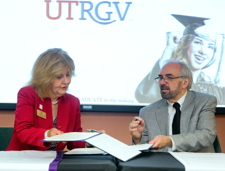 STC President Shirley Reed and UTRGV President Guy Bailey Signing document