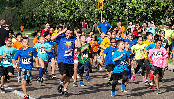 Actor Efren Ramirez (#5065) ran with a group of children in the UTRGV 16th annual STEMS Fun Run on Saturday