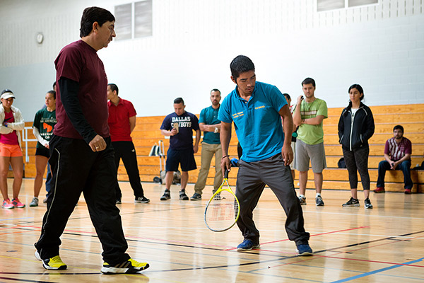 Competitive blind tennis athlete Octavio Magallán walks the court to get a feel for the boundaries