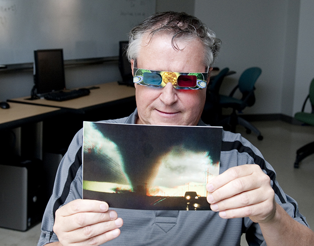 "Doug Robinson, a radio and TV teacher at Santa Rosa High School, checks out a 3-D picture of a tornado, during the ""El Niño: A Driver of Global Weather and Climate"" breakout session at Monday's HESTEC. (UTRGV Photo by Josué Esparza)"