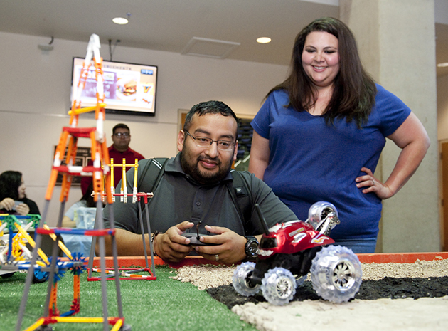 Edcouch-Elsa High School teachers Oliver Sabedra and Felicia Urbina learned about ways to teach students about the STEM fields during HESTEC Educator Day on Monday. And, they got to play with robots during an engineering breakout session. UTRGV Photo by Josué Esparza)