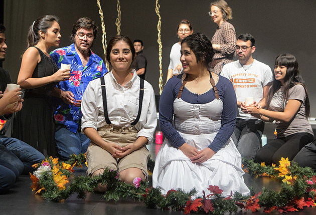 Sylvia Lopez, left, a senior vocal music education major from Harlingen, performs the role of Hansel, and Alexa Salas, a senior vocal music education major from Brownsville, is singing the part of Gretel, in the UTRGV opera 'Hansel and Gretel' at the Arts Center in Brownsville. They are shown here in rehearsal. (UTRGV Photo by David Pike)
