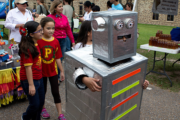 Young visitors To UTRGV's RiSA Community Day participated in a Robot Parade at Linear Park in Brownsville.