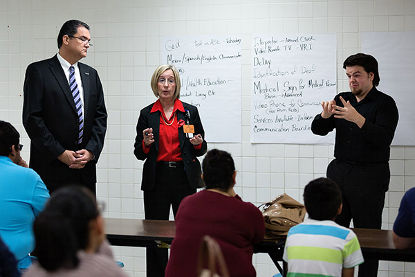 Dr. Shawn Saladin, Linda Nelson, and Richard Trevor help participants at a Town Hall Meeting for the Deaf and Hard of Hearing at Escandón Elementary School in McAllen