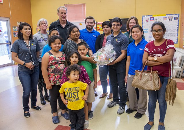 UTRGV students on Wednesday, Nov. 23, delivered turkeys and Thanksgiving food baskets to families from six Valley communities.