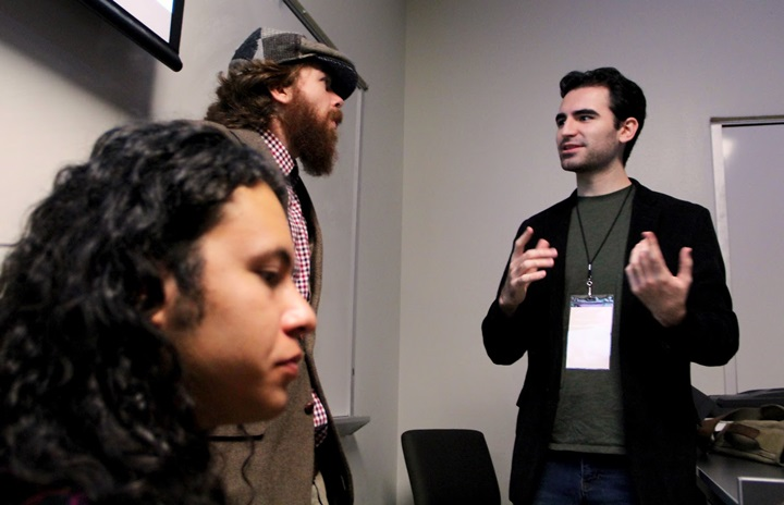 "Eduardo Gamba, UTRGV alumnus and director of the short film, ""Visit,"" talks with crew members while shooting the film."