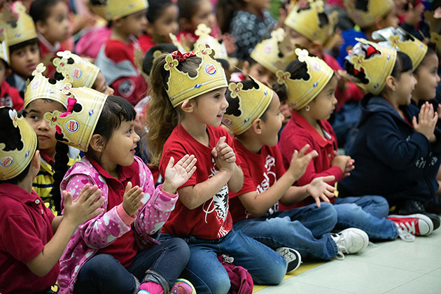 "Children at Emiliano Zapata Elementary School in Mission applauded author Diane Gonzales Bertrand, who gave away copies of her book, ""A Bean and Cheese Taco Birthday"" on Friday. Her presentation was part of the Reading Rock Stars program, organized by the Texas Book Festival as part of UTRGV's annual FESTIBA week. (UTRGV photo by Paul Chouy)"