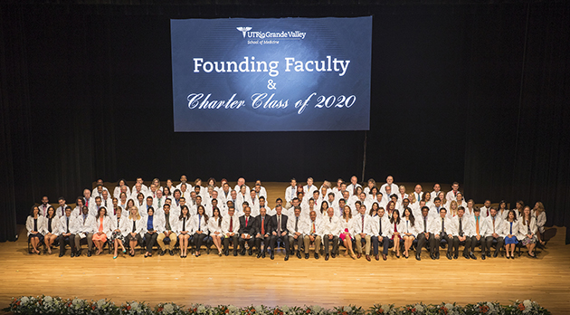 The UTRGV School of Medicine Founding Faculty and the Charter Class of 2020 pose for an official group photo to conclude the White Coat Ceremony on Saturday, July 23, 2016, at the UTRGV Performing Arts Center on the Edinburg Campus. (UTRGV Photo by David Pike)