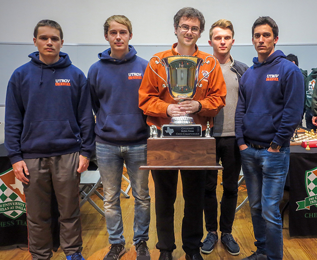 UTRGV Chess Coach Bartek Macieja, center, holds the 2016 Texas Collegiate Super Finals trophy, with Team A members, from left: Grandmaster Anton Kovalyov, senior computer science major from Canada; Grandmaster Andrey Stukopin, junior physics major from Russia; Grandmaster Vladimir Belous, freshman finance major from Ukraine; and Grandmaster Carlos Hevia, freshman computer science major from Cuba. (UT Dallas Courtesy Photo by James Stallings)