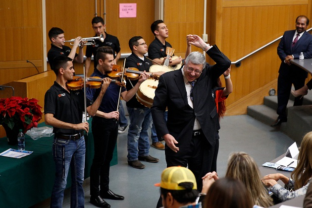 UTRGV College of Engineering & Computer Science Dean Dr. Alexander Domijan takes a break from discussing the college's strategic plan to dance with a UTRGV student while the university's mariachi members performed at the CECS Town Hall on Friday, Dec. 09, 2016 at the Engineering building in Edinburg, Texas. UTRGV Photo by Paul Chouy