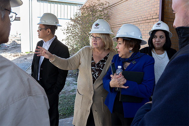 Officials from UTRGV and the Pharr-San Juan-Alamo school district on Feb. 15 celebrated the launch of the future site of PSJA's Early Head Start campus on Fir Street in Pharr. The former Buckner Elementary School is about 60 years old and undergoing renovation. Here, Deborah Daniels (at center), a child care program specialist with Region V1 of the Administration for Children and Families, Office of Child Care, speaks with Dr. Hilda Medrano, a UTRGV professor in the College of Education and P-16 Integration, and principal investigator and director of the Early Head Start grant. (UTRGV Photo by Paul Chouy)