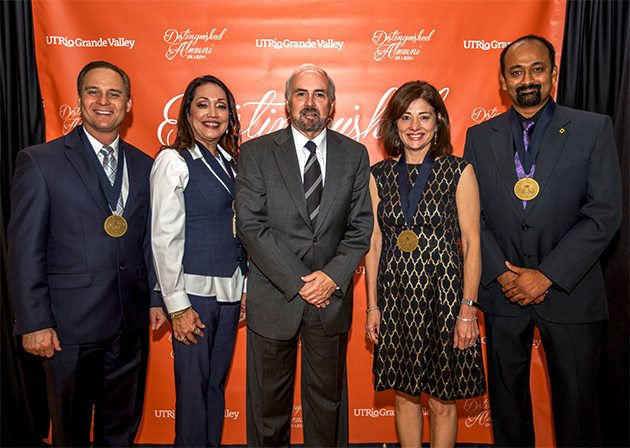 UTRGV has honored four outstanding graduates with the highest honor alumni can receive – the Distinguished Alumni Award. Recipients accepted their awards Thursday, April 27, 2017, at a ceremony on the Edinburg Campus. From left are honorees Michael J. Williamson and Norma Teran, UTRGV President Guy Bailey, and honorees Alice L. Rodriguez and Sandesh V. Kadur. (UTRGV Photo by Silver Salas)