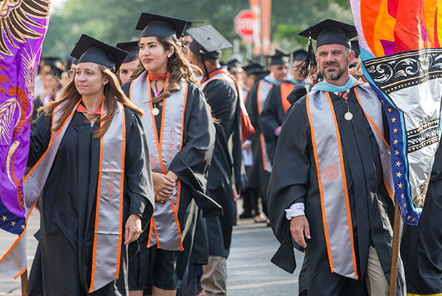 The rain cleared Friday afternoon in Brownsville, just in time to make way for the parade of colorful gonfalons that mark UTRGV commencement ceremonies.