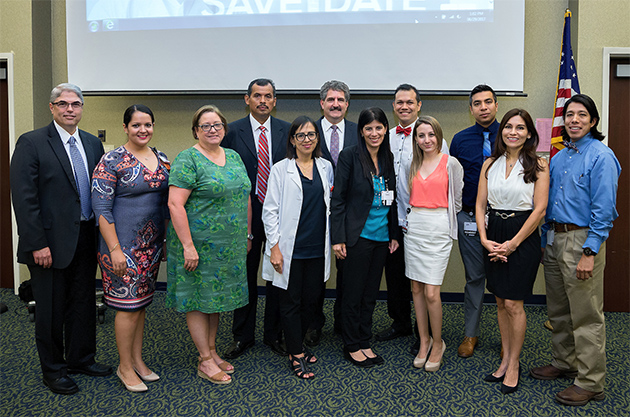 The UTRGV School of Medicine held a reception to welcome the inaugural cohort of medical residents for its Family Practice Residency Program with Knapp Medical Center. From left are Dr. Rene Lopez, CEO of Knapp Medical Center; Alexandra Smith, program coordinator for the Knapp Medical Center/UTRGV Family Practice Residency Program; Dr. Yolanda Gomez, associate dean for Graduate Medical Education, UTRGV School of Medicine; Dr. Miguel Sanchez Rivas, medical resident; Dr. Rosemary Recavarren, chief medical staff, Knapp Medical Center; Dr. Steven Lieberman, interim dean, UTRGV School of Medicine; medical residents Dr. Carolina Gomez De Ziegler, Dr. Eddy Berges, Dr. Eliana Costantino-Burgazzi, Dr. Diego Moreno and Dr. Marita Sanchez Sierra Marino; and Dr. Miguel Tello, incoming chief of staff for Knapp Medical Center, associate director of the Knapp Family Practice Residency Program and associate professor in the UTRGV School of Medicine Department of Family Medicine. (UTRGV Photo by Paul Chouy)