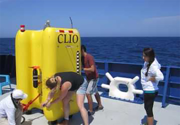 Researchers and students aboard the Research Vessel Neil Armstrong prepare CLIO – the world's first unmonitored underwater vehicle designed completely for studying the microbiology and biochemistry of the ocean – for underwater testing, where it will filter water for microorganisms. (Courtesy Photo)