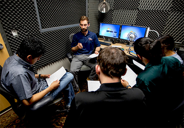 "Students from the UTRGV School of Medicine are recording ""A Voice in Your Ear: Podcasts as a Tool for Medical Education,"" to provide advice and tips for incoming medical students. The recording studio was provided by the UTRGV Center for Online Learning Technology (COLTT) in Edinburg. Michael LaPelusa, at center, goes over some tips for the podcast with Joy Alvarado, Shawn Izadi, Keith Garrison and Ramiro Tovar. (UTRGV Photo by Silver Salas)"