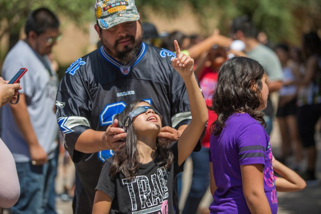 Members of The University of Texas Rio Grande Valley community gathered on the Edinburg Campus on Monday, Aug. 21, 2017, along with families with small children, Boy Scouts, soccer players and others, to watch the historic total solar eclipse. The total eclipse is when the New Moon passes between the Earth and the Sun and casts its shadow on Earth, appearing to block out the sun. In Edinburg, only about 50 percent of the sun was blocked out at its peak hour, with totality experienced in other parts of the country. (UTRGV Photo by David Pike)