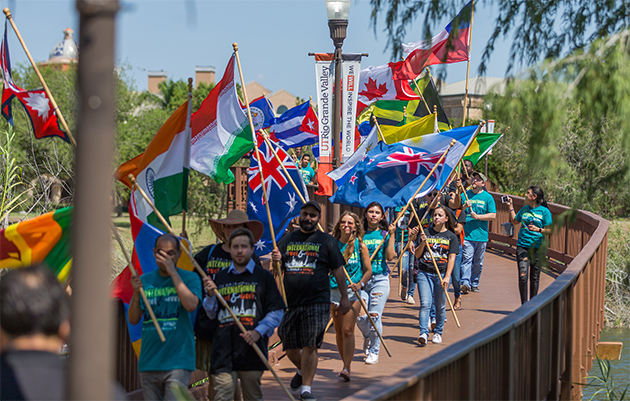 Dozens of international students holding colorful flags from a variety of countries marched across The University of Texas Rio Grande Valley's Edinburg and Brownsville campuses this week as part of UTRGV's Best Week Ever celebrations. The International Meet & Greet event was held Wednesday in Edinburg and Thursday in Brownsville. UTRGV has 774 international students representing 60 countries, including Mexico, India, China, Brazil, Venezuela and Bangladesh. The Brownsville Campus Drumline, led by Dr. Joe Moore, led the parade of colorful international flags. (UTRGV Photo by David Pike)