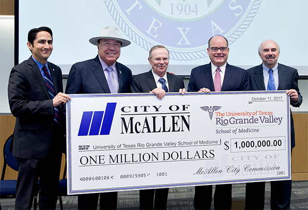 The City of McAllen presented a check for $1 million to The UTRGV School of Medicine on Wednesday, Oct. 11, 2017, at the Medical Education Building on the Edinburg Campus. From left are McAllen City Commissioner Omar Quintanilla; Sen. Juan 'Chuy' Hinojosa (Texas District 20, D-McAllen); McAllen Mayor Jim Darling; Dr. John Krouse, UTRGV vice president for Medical Affairs and dean of the School of Medicine; and UTRGV President Guy Bailey. (UTRGV Photo by Paul Chouy)