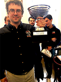 UTRGV Chess Coach GM Bartek Macieja proudly displays the President's Cup trophy, awarded to the UTRGV Chess Team as the 2018 National Champions of the Final Four of College Chess competition. The tournament was held March 31-April 1 at the Marshall Chess Club in New York City. (Courtesy Photo)