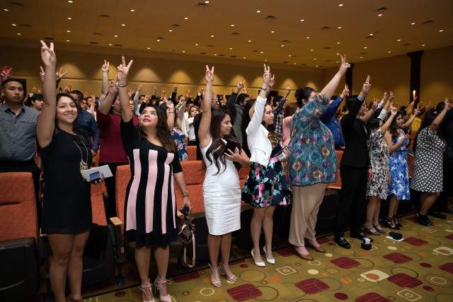 UTRGV students put their V's up for the university fight song, proudly displaying their new class bling, during the Inaugural UTRGV Ring Ceremony, Saturday, May 6, 2017, at the Edinburg Conference Center at Renaissance. (UTRGV photo by Paul Chouy)