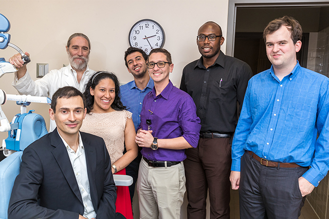 Dr. Gabriel De Erausquin (back row, at left), professor and founding chair of the UTRGV School of Medicine's Department of Psychiatry, Neurology and Neurosciences, is shown here with the first cohort of UTRGV psychiatry residents: (front row, seated) Dr. Andry Shalomov, 35, American University of the Caribbean School of Medicine, Sint Maarten; (standing, middle row, from left) Dr. Lessley Chiriboa, 28, Rutgers University, Robert Wood Johnson Medical School; Dr. Karel de Leon, 34, Universidad Nacional Autónoma de Mexico, Facultad de Medicina; Dr. Scott Wallace, 28, University of Arizona – Tucson College of Medicine; (back row, center) Dr. Camille Merhi, 25, University of Balamand, Faculty of Medicine and Medical Sciences, Lebanon; and Dr. Karachí Igwe, 29, St. George's School of Medicine, Grenada. (UTRGV Photo by David Pike)