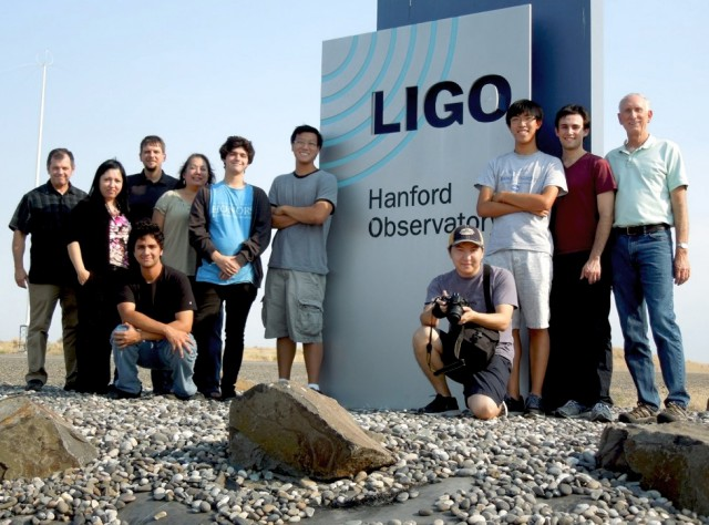 Shown here at the entrance to the LIGO Hanford Observatory in Richland, Washington, are REU (Research Experiences for Undergraduates) students who spent the summer doing research and visiting the laboratory. At left is Robert Stone, a PhD candidate in Physics in the UTRGV cooperative doctoral program, under the supervision of Dr. Soma Mukherjee; third from left, standing, is UTRGV and CGWA faculty Dr. Volker Quetschke, who has been working on gravitational-wave detector hardware since 2000 and has been a member of the CGWA since 2009; and kneeling, fourth from right with cap, is Darkhan Tuyenbayev, a PhD candidate in Physics conducting his research at LIGO Hanford Laboratory under UTRGV's Quetschke and UTRGV Adjunct Professor Richard Savage (at far right), a LIGO Hanford scientist. (UTRGV Courtesy Photo)