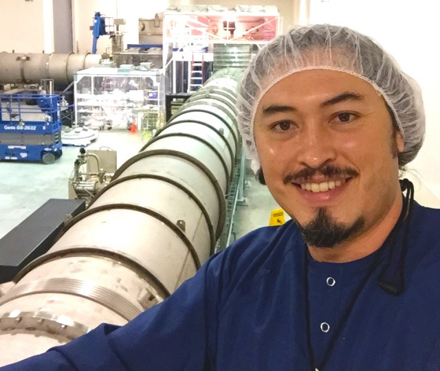 Dr. Guillermo Valdes, shown here in the LIGO Livingston Observatory standing by one of the vacuum tubes, received his PhD in Physics under a cooperative doctoral program under the supervision of Dr. Mario Diaz, director of the UTRGV Center for Gravitational Wave Astronomy. Valdez currently is a postdoctoral scientist working at the LIGO laboratory. (UTRGV Courtesy Photo)