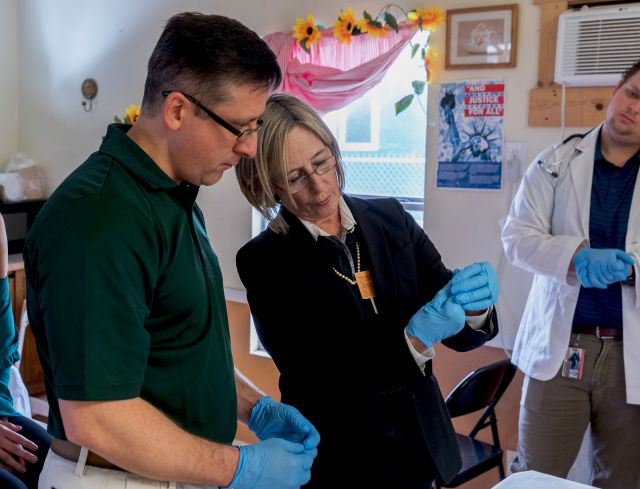 Linda Nelson, senior director of Clinical Operations for the UTRGV School of Medicine, instructs first-year medical student Richard Wagner on how to prepare a flu vaccine.