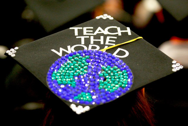 Teach the World graduation cap art.