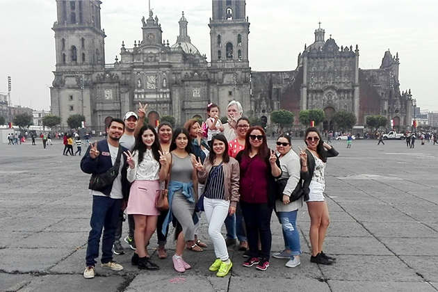 UTRGV students attending a summer study abroad communications class in Mexico City pause for a photo in front of the Catedral Metropolitana on the Zócalo, the city's main square. The group includes (from left) Esai Torres, Luis Cavazos, Daliarlene Saenz, Vanessa Soto, Ninah Caquias, Lupita Strong, Adriana Gutierrez, Bianca Lopez, Osmara Garcia, Sarah Peña and Yvette Salinas. In the back row is Dr. William Strong, UTRGV communications professor who conducted the class, holding his daughter, Scarlett. (Courtesy Photo)