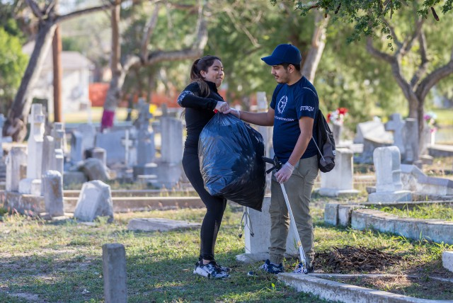 Here, students are seen picking up trash at the Old City Cemetery in Brownsville. (UTRGV Photo by David Pike)