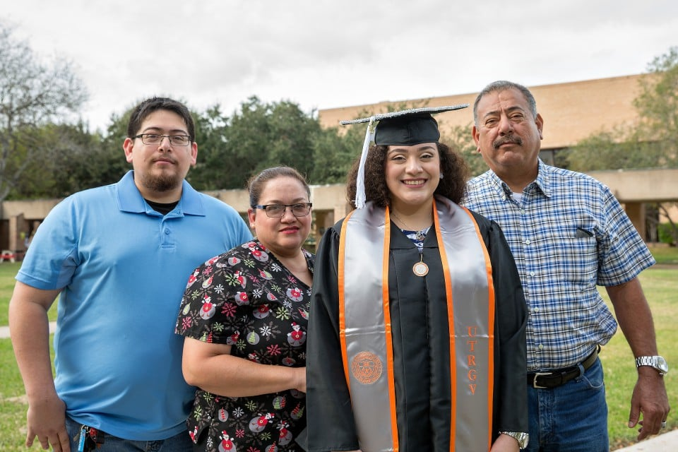 "UTRGV senior Ester Navarro, of McAllen, will accept her bachelor's degree in mass communication with a concentration in public relations on Saturday, Dec. 15. Her family will be seated in the bleachers watching her walk across the stage at the McAllen Convention Center to receiver her diploma. Her family is grateful she never gave up on her ambitions and picked herself up to continue. Ester is eager to thank her family for their support and not giving up on her. ""Even when I had my breakdowns, when I switched my major like three times. Thank you for never giving up on me,"" she said. Pictured in the photo from left to right is Pablo Navarro Jr. (brother), Sylvia Navarro (mother), Ester Navarro, and Pablo Navarro Sr. (father). (UTRGV Photo by Paul Chouy)"