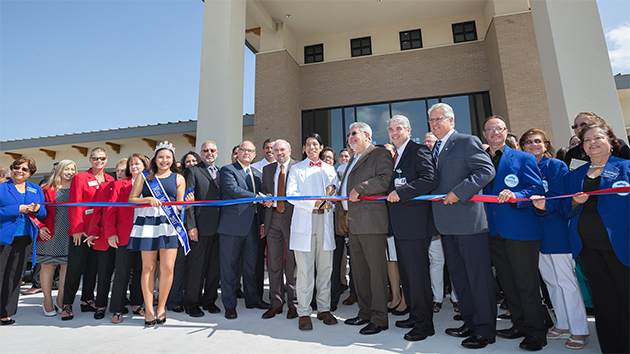 Officials from The University of Texas Rio Grande Valley, Knapp Medical Center and the community celebrate the completion of the new Knapp Medical Center/UTRGV Family Practice Residency Clinic in Mercedes Thursday, July 20. The clinic, which will house the Knapp Medical Center/UTRGV Family Practice Medical Residency Program, is expected to open in late August. (UTRGV Photo by Paul Chouy)