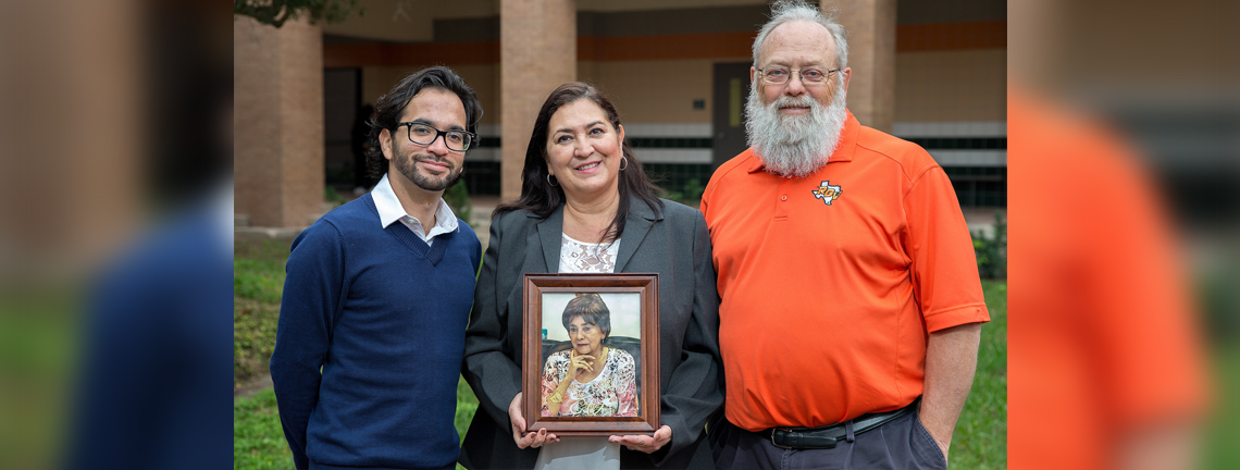 Three generations of rehabilitation services students at UTRGV and legacy institution UTPA – Bonnie Marie Notergiacomo, her son Jesus Alberto Basañez, and her mother Ernestina Notergiacomo (shown here posthumously, in a framed photograph) – all have been involved in the university's Rehabilitation Services program, and all have been recipients of the federal RSA Scholarship from the U.S. Department of Education. (UTRGV Photo by Paul Chouy)
