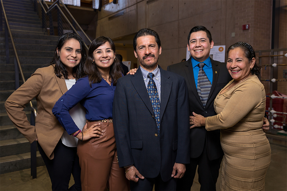 UTRGV manufacturing engineering grad student Francisco Torres Diaz (fourth from left), will accept his MSE during UTRGV commencement ceremonies Dec. 15 in McAllen. He says his family, shown here, was his strongest support system during the roughest of times. In the photo, from left, are family friend Berenice Martinez; his sister, Carmen Torres; his father, Francisco Rafael Torres Violante; Francisco; and his mother, Maria del Carmen Diaz Barrios. (UTRGV Photo by Paul Chouy)